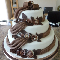 Chocolate And Ivory Wedding Cake Chocolate 2 tone Roses with chocolate fondant swags and Ivory fondant icing.