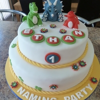 1St Birthday Dinosaur Cake Maderia sponge cake covered in fondant with hand made Dinos