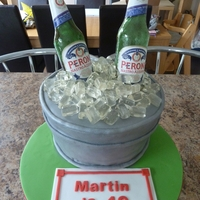 Beer Bottle Cake For my Brother in law... Cake barrel with sugar Bottles and Fox's glacier mints for ice!