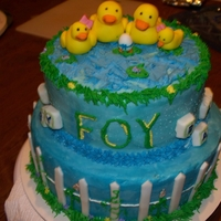 Baby Shower 2 tier baby shower cake...fondant ducks to represent each member of family, and egg with blue ribbon to show unborn baby boy...wanted it to...