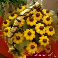 Yellow Sunflower Cookies A sunflower cookie bouquet with malt balls for the center of the cookies...
