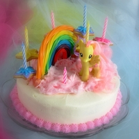 Rainbow Pony Cake A rainbow pony cake with pink cottoncandy clouds, a candy rainbow and cookie stars...