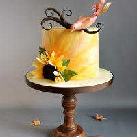 Autumn Bird This is a cake I made to experiment with Amber Adamson's Creamy Paint method. I used ACP to paint the cake and to color wafer paper...