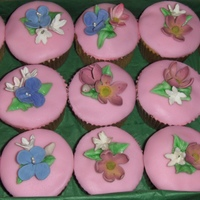 Spring Cupcakes Vanilla flavored cupcakes, for a wedding shower, covered with pink fondant and topped with sugar spring flowers