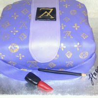 Louis Vuitton Birthday Cake Louis Vuttion Purse Cake... Vanilla Cake with Strawberry filling. This is a small one and my hand was getting tired of trying to do all the...