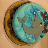 My Daughter's Dolphin Cake Painted the waves, with edible fondant rocks, seashells, and graham cracker sand.