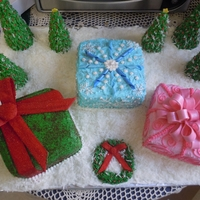 Christmas Present Cake This is 3 square cakes made to look like christmas presents, I used coconut to represent snow.