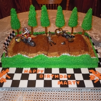 Motorcycle Birthday Cake I made this cake for my mothers boyfriend who races KTM motorcycles.
