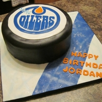 Oilers Hockey Puck Cake