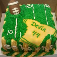 Birthday Cake Football cake, Red velvet with almond flavor simple syrup. Football is made with rice krispy treats and brown fondant as a cover and jersey...