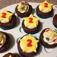 Star Birthday Cupcakes Birthday cupcakes for my son. Gluten free chocolate cake with vanilla butter cream. Fondant stars and cute star sprinkles on a 1M swirl.