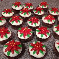 Poinsettia Cupcakes Gingerbread cupcakes with cream cheese frosting with a piped buttercream poinsettia. Gluten free.