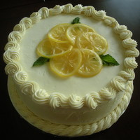 Lemon Cake Lemon cake with lemon curd filling and vanilla buttercream. It is garnished with candied lemon slices and mint leaves. This is a gluten...