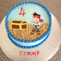 Jake And The Neverland Pirates 4th birthday cake for my son. It's a strawberry cake with strawberry cream filling and vanilla buttercream with fondant accents.