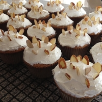 Almond Cupcakes Gluten free almond cupcakes with almond IMBC garnished with slivered almonds. Simple decoration but I think it works.