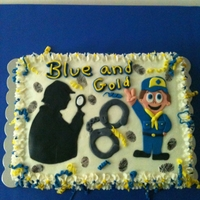 Blue And Gold Spy Theme This is a blue and gold cake for Cub Scouts. Frosted in buttercream with fondant accents.