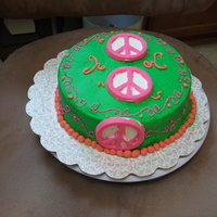 Peace Sign Cake It's a peace sign cake for a friend of mine. I made the peace signs out of Merken's Candy disks, and piped the pink swirls. The...