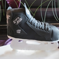 Hockey Skate Graff Hockey Skate sculpted cake for a grooms cake.