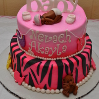 Zebra Print Babyshower Cake Two tier, 10 in. white cake and 8 in. strawberry buttercream cake with fondant accents.