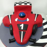 Racing Car Birthday Cake   I made this car birthday cake for a little boys 1st birthday. Please visit my page at http://www.facebook.com/Serascakecreations .
