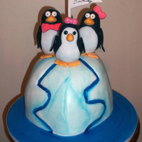 Penguins Orange Pineapple cake filled with guava butter cream, covered with fondant. Penguins made out rice crispies and covered with fondant. The...
