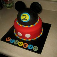Mickey Mouse Clubhouse A birthday cake for a Mickey Mouse Clubhouse theme party. Chocolate cake with a vanilla almond buttercream, covered in fondant. The ears...
