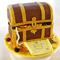 Treasure Chest Cake  Treasure Chest cake for my son's 4th birthday. Lid is styrofoam. Pearls are made out of fondant dusted with pearl lustre dust; coins...