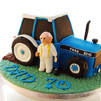 Ford Tractor Cake  A 3d Ford tractor cake for a bowling-mad farmer's birthday! It was supposed to be finished with a brown ribbon around the cake drum (...