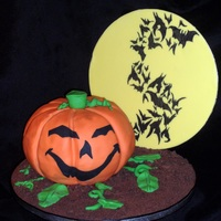 Jack O Lantern In The Batty Moon Jack o Lantern is a chocolate chip cake with chocolate buttercream. Moon was made by covering cake card with pale yellow sugarpaste. Dirt...