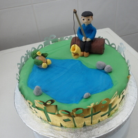Fishing Gone Wrong This is a surprise birthday cake for my dad. Scene is him fishing with a duck laughing at him because he has caught an old boot. This is...