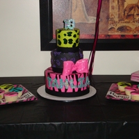 18Th Birthday Cake Zebra and cheetah animal prints with grey and black marbled fondant on the middle tier. Prints were hand painted, bow is fondant, and...