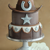 Cowboywestern Theme Cake The Two Tiers Are Chocolate Cake With Hazelnut Buttercream Covered In Chocolate Ganache And Fondant The Hat Is Cowboy/western theme cake. The two tiers are chocolate cake with hazelnut buttercream, covered in chocolate ganache and fondant. The hat is...