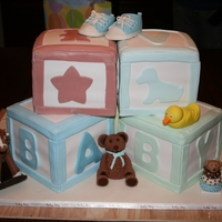 Baby Shower Building Blocks Cake 5 -Building blocks cakes, one in the back to help support the top ones. Modeling chocolate rubber ducky, rocking horse, fuzzy teddy bear &...