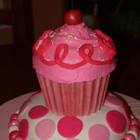 Pinkalicious fondant and buttercream with candy melt shell for cupcake bottom.