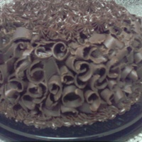 Mother's Day Chocolate Cake filled with Chocolate Icing, covered in Chocolate Ganache and Handmade Chocolate curls.