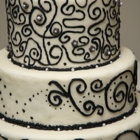 First Time Black And White Cake This is a white cake filled with strawberries iced with buttercream and piped with black buttercream icing.