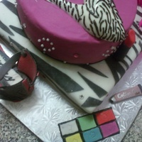 The Glamorous Life This was a cake made for a birthday. Both tiers are Chocolate Cake. Eye shadow, Custom Shoe, Compact, Lip Gloss, and Lipstick are all made...