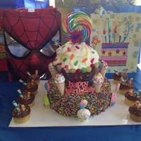 Candy Cupcake Cake This was for my son's 2nd birthday. devils food with chocolate bc on the bottom. top is poundcake with bc. cupcakes are yellow cake...