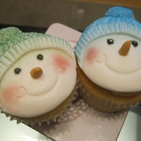 Cute Snowmen   Cupcakes decorated with snowman made with mould and hand painted with edible luster powder