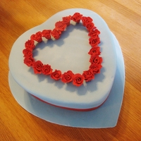 Valentine's Cake For My Sweetheart wedgewood blue heart shaped cake with red sugar roses