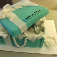 Tiffany & Co. Box Cake With A Diamond Ring Wedding cake with buttercream filling and fondant decorations. The diamond ring is actually a glass stone.