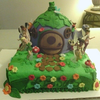 Disney Fairy House Cake This is an almond cake with butter cream filling. Bottom tier is covered in green butter cream icing with fondant decorations and top tier...