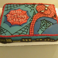 Spiderman Cake This is a almond cake covered in dark blue butter cream with piped spider webs and Spiderman and birthday sign is made with fondant.