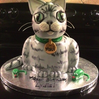 "Maui, Kitty Cake This is Maui, the birthday girl's cat. Maui is made from 3 layers of chocolate cake (8"") and vanilla icing. The head is RKT...."
