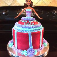 Barbie Cake 3 layers of chocolate cake with a vanilla buttercream. Real Barbie put in cake so birthday girl can have one to play with after they are...