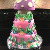 Tinkerbell Cake  All chocolate cakes - chocolate icing on mushroom and bottom tier and vanilla icing in the middle tier. All cakes are covered in fondant...