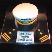 Lieutenant Commander Cake LCDR cover is made from chocolate cake and frosting, covered in fondant. The brim of the cover is made from cardboard and fondant......