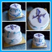 Louella's Cake Pisces themed cake. 'Waves' or scrolls are made out of modelling chocolate.