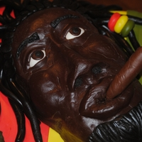 Jamaican Rasta Man Cake covered in fondant ...Rice Krispies face covered in modeling chocolate...modeling chocolate dreads