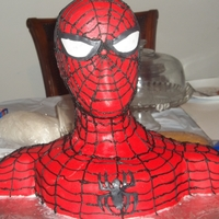 Spiderman Bust Cake Made with styrofoam wig head, two 10in rounds, 1 8in round cut in fours...covered in mmf, stripes are bc